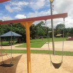 Swings at Playground at Trinity Beach Coast Watchers Park